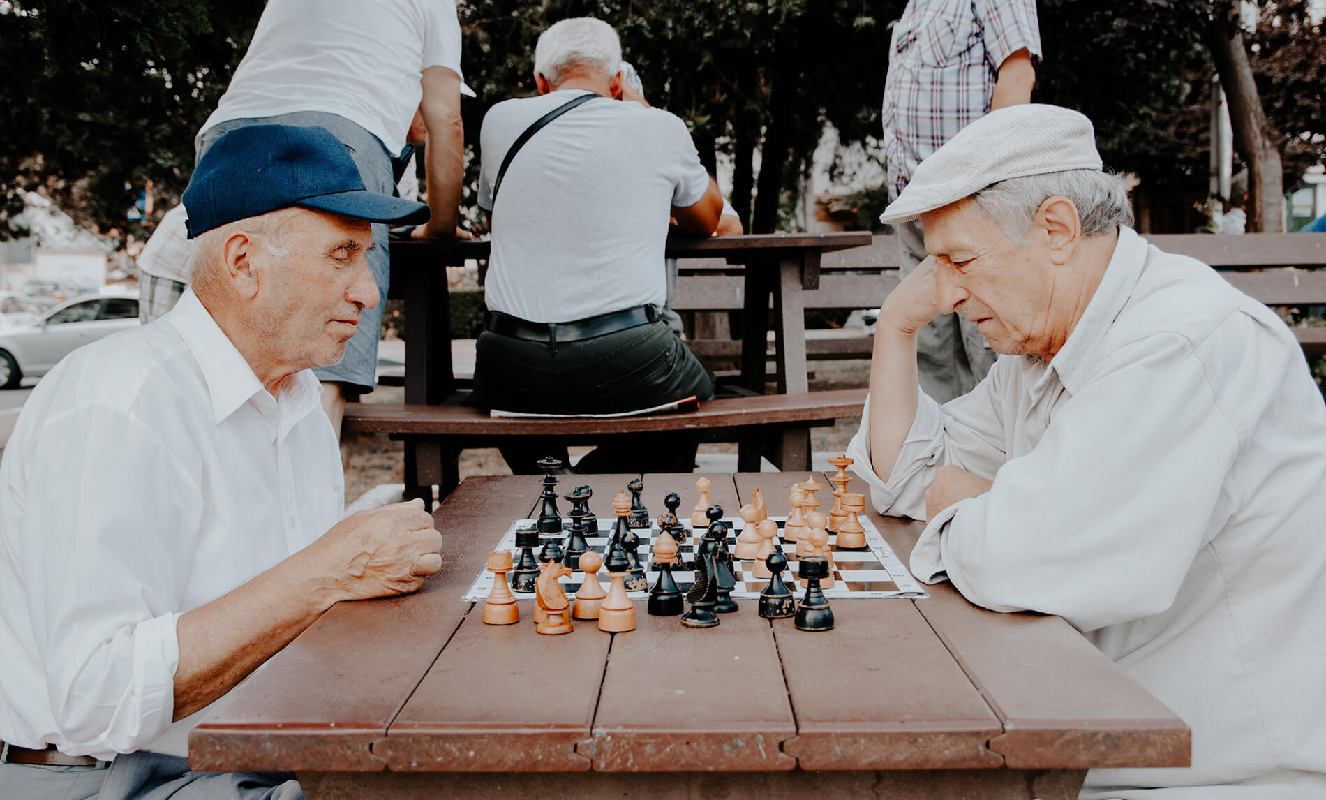 Two senior residents and dementia patients playing chess