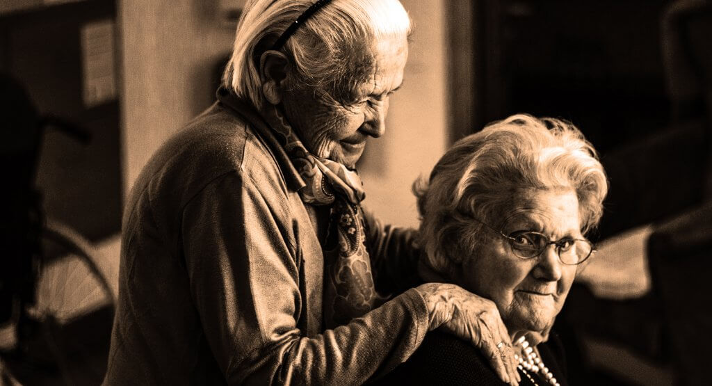 Two seniors in an assisted living facility