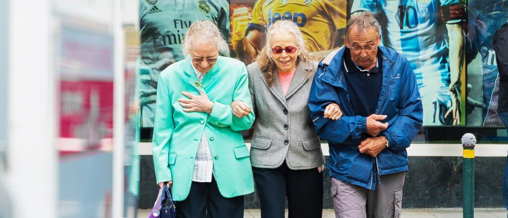 Three senior citizens going for a walk in the city